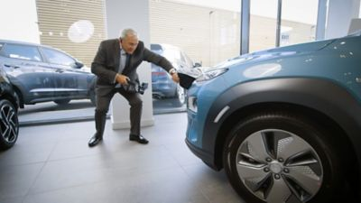 A Hyundai dealer giving a live video tour of a KONA Electric using a GoPro action camera.